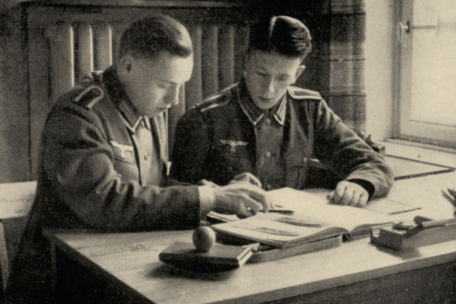 Medical students in uniform in a dormitory around 1940